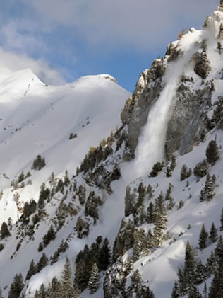 Avalanche pouring off Hellgate Cliffs, Alta, Utah